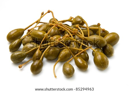 capers close up on white background - stock photo