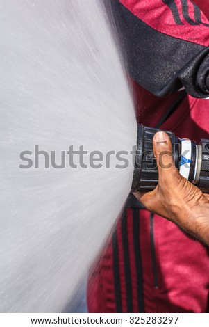 Capita per water during fire training in the industry. - stock photo