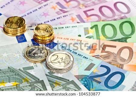 Capital augmentation: euro banknotes and coins - stock photo