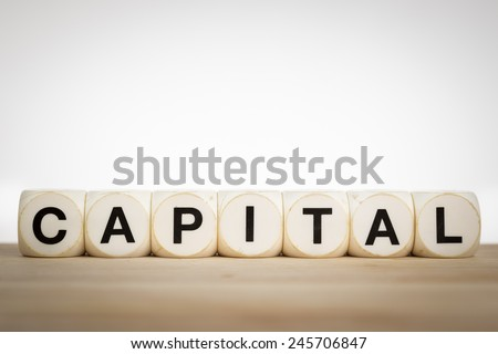 Capital is a type of good that can be consumed now, but if consumption is deferred an increased supply of consumable goods will be available later. - stock photo