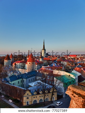 Capital of Estonia, Tallinn is famous for its World Heritage old town walls and cobbled streets. The old town is surrounded by stone walls and distinctive red roofs - stock photo
