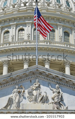 Capitol Building east facade dome detail with flapping US flag - Washington DC - stock photo