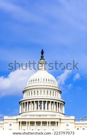 Capitol Building in Washington DC under blue sky - stock photo
