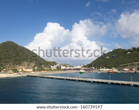 Capitol City of Philipsburg St Martin bay with Moored boats and Mountains in the Carribean - stock photo