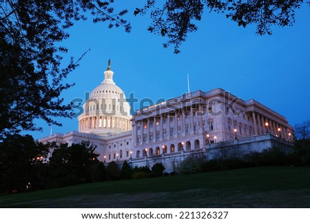 Capitol Hill  building panorama at dusk with light and blue sky, Washington DC. - stock photo