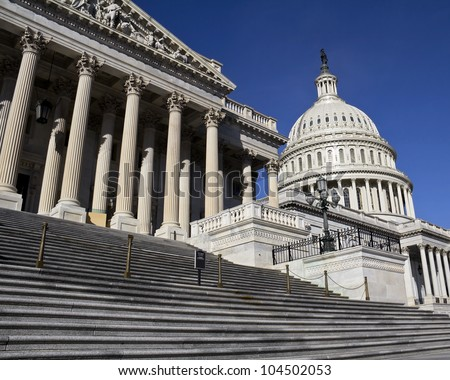 Capitol, located in Washington, DC, is the building in which the US Congress meets. It is at the east end of the National Mall - stock photo