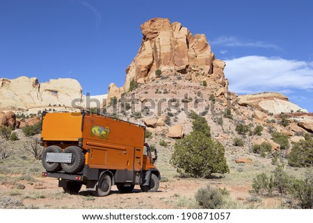 CAPITOL REEF NATIONAL PARK, UTAH, USA - May 2: Custom Expedition Vehicle RV driving on dirt road in the Capitol Reef, Utah on May 2, 2014. - stock photo