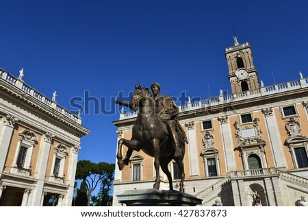 Capitol Square in Rome, with bronze equestrian statue of the emperor Marcus Aurelius and building designed by the famous renaissance artist Michelangelo - stock photo