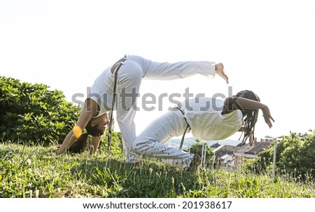 Capoeira couple of awesome stunt outdoors  - stock photo