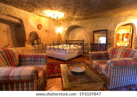 CAPPADOCIA, TURKEY - JUN 16: Cave bedroom on June 16, 2011 in Cappadocia, Turkey. The best historic mansions and cave houses for tourist stays are in Urgup, Goreme, Guzelyurt and Uchisar. - stock photo