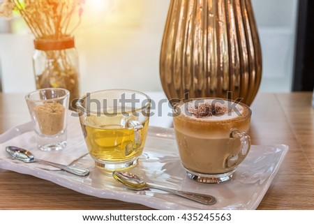 Cappuccino coffee cup and tea,Hot coffee in white mug,hot tea, Fill color filter. - stock photo