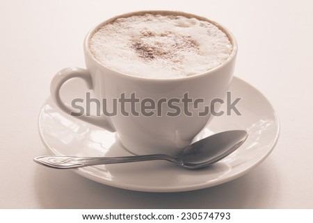 Cappuccino cup on a light background. Shallow depth of field - stock photo