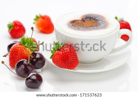 cappuccino in a cup in the shape of hearts,cherry  and strawberries isolated on white - stock photo