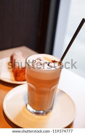 cappuccino in a  glass - stock photo