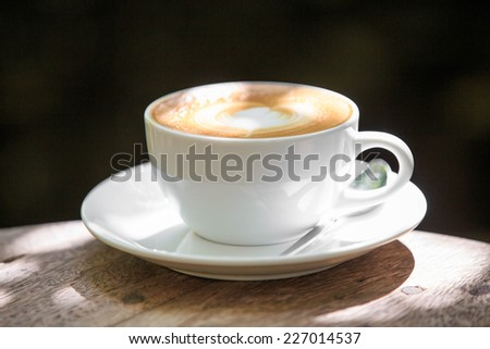 Cappuccino or latte coffee with heart shape. - stock photo