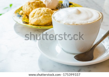 Cappuccino with scone - stock photo