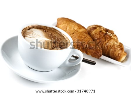 Cappuchino With Croissant isolated in studio. Shallow d o f - stock photo