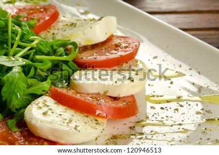Caprese salad, italian appetizer with mozzarella and tomatoes - stock photo