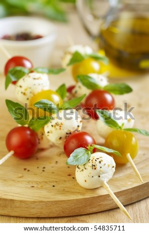 Caprese salad on wooden sticks - stock photo