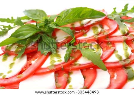 Caprese salad with mozarella cheese, tomatoes and basil - stock photo