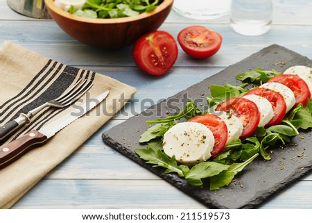 caprese salad with rocket instead of basil - stock photo