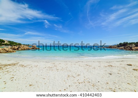 Capriccioli beach under a cloudy sky, Sardinia - stock photo