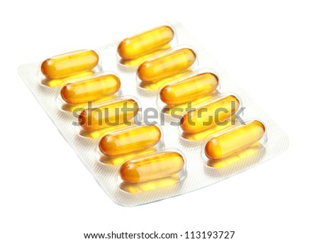 Capsules packed in blisters, isolated on white - stock photo