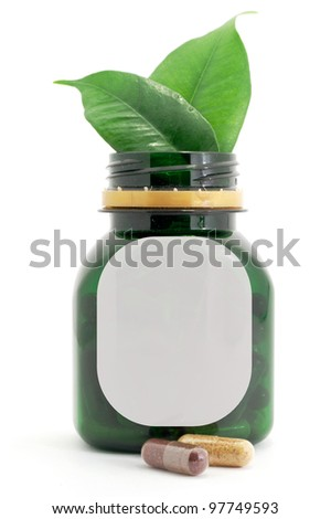 Capsules Pills Bio and Bottle with green leaf - stock photo