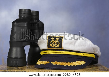 captain hat with black binoculars - stock photo