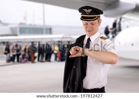 Captain waiting for passengers boarding - stock photo