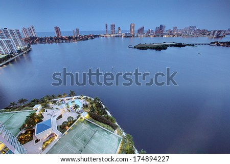 Captivating aerial view Aventura Bay, with Pool and Tennis Courts, North of Miami Florida  - stock photo