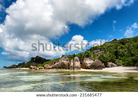 Captivating Lagoon with Big Rocks, Green Trees and High Hill on the Water Side. Located at Seychelles Island. - stock photo