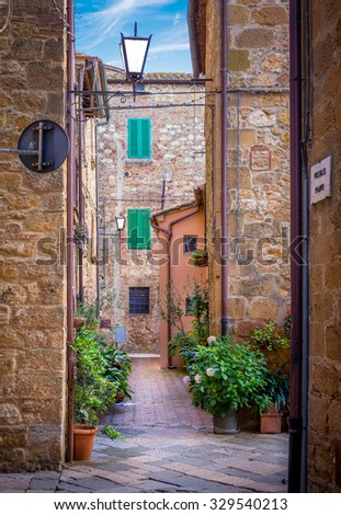 Captivating narrow street of old Pienza town in Tuscany - stock photo