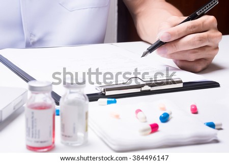 capture when doctor writing - stock photo