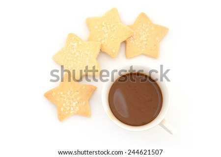 capuccino coffee in vintage style cup and star cookie in coffee break time - stock photo