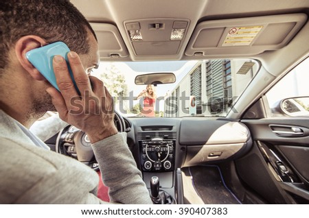 Car accident. Distracted driver on the phone running over a pedestrian. Concept about transportation and driving dangers - stock photo