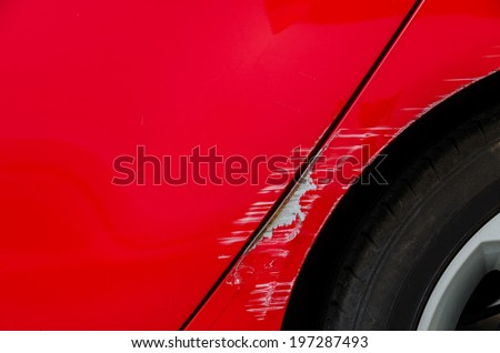 Car accident - Smashed body of red car - stock photo