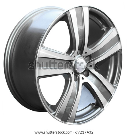 car alloy wheel, isolated over white background - stock photo
