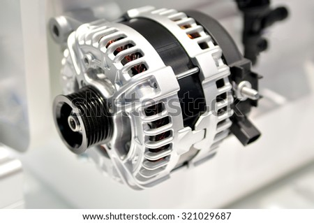car alternator with drive wheel. - stock photo