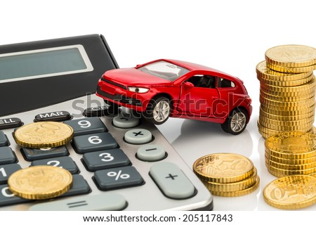 car and calculator. rising costs for buying a car, leasing, workshop, refueling and insurance - stock photo