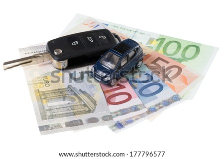 Car and Euro banknotes with car keys isolated over a white background / Car and money - stock photo
