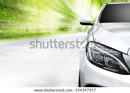 car and road in forest  - stock photo