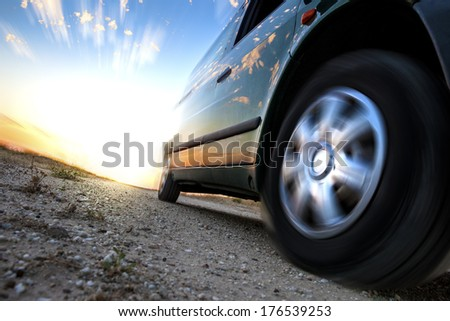 Car and speed. Sunset scenery and fast car outdoor - stock photo