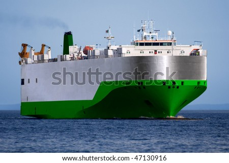 Car and Truck Transporter underway at sea. - stock photo