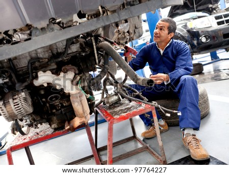 Car at the mechanic being fixed after it broke down - stock photo