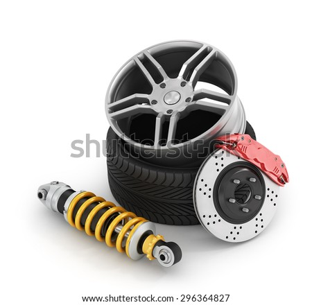 Car brakes with absorbers, tires and rims on the white background. - stock photo