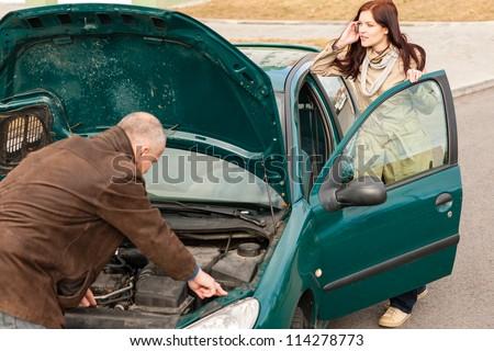 Car breakdown woman calling for road assistance man repair motor - stock photo