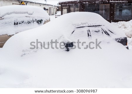 Car buried in snow - stock photo