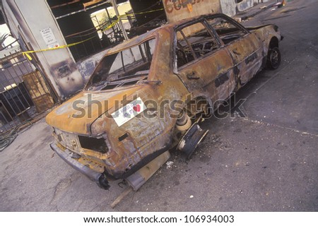 Car burned during 1992 riots, South Central Los Angeles, California - stock photo
