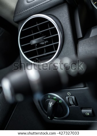 Car cabin details - close-up of vent - stock photo
